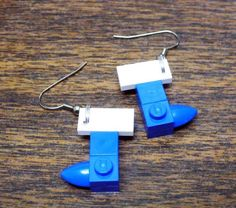 Items similar to Mini Blue Stocking Dangle Earrings on Etsy Lego Advent, Blue Stockings, Usb Flash Drive, Dangle Earrings, Dangles, Trending Outfits, Unique Jewelry, Mini, Handmade Gifts