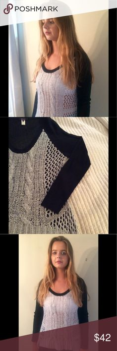 Chic black and grey sweater.  Very delicate. 85% acrylic/15% nylon.  Hand wash cold.  Very delicate.  See-through.  The model is wearing a bralette but can be worn with camisole or tank underneath.  Approximate measurements- 23.5 in width from underarm to underarm ; from shoulder down- 26 inches. The sides of the sweater are longer on the side and shorter in the center.  The model is size medium and sweater is large.  Purchased at SaraJane boutique in Chicago.  Worn twice.  This sweater is…