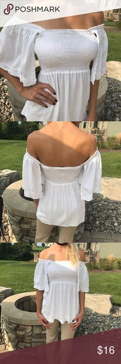 Bright white sexy top Angel sleeves; can be worn on or off the shoulders; light airy fabric; perfect condition! Size tag cut out but it's a small Tops Tunics
