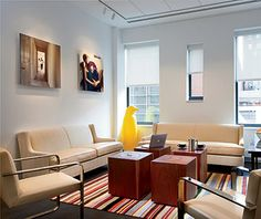 It List - The Best New Hotels: 21C Museum Hotel Cincinnati  --- for the home: couch, photos on the wall
