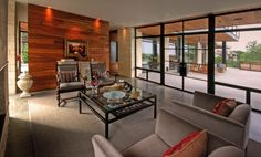 COMFORTABLE LUXURY HOME WITH NATURAL FINISHES BY CORNERSTONE ARCHITECTS