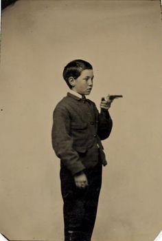 ca. 1865, [Unidentified Boy with Gun]