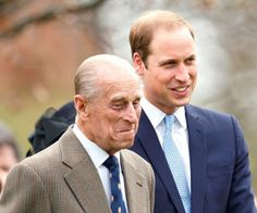 Prince Philip with grandson Prince William at the unveiling of a new statue in Windsor in 2014.