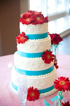 Wonderful red and aqua wedding cake set over 5 tiers decorated with swirls, aqua lace and red gerbera daisies. Cake made by Colleen Cakes 11844 Moorhen Circle Keller, Texas 76244-7587 (817) 741-5577 colleen@colleenscakes.com More Great Looks Like This