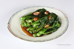 Chinese broccoli with oyster sauce is one of my most favorite things to order, EVER. Something about the crisp texture when you bite down on it, mixed with the salty and sweet flavor from the oyste...