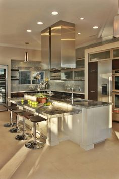 Love: the sparkly back splash, marble counters on the island + the different levels at the island.