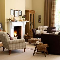 Yellow traditional living room with tartan upholstery