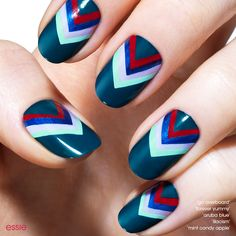 Aim to please. This bold nail art is a pleasant departure from the basic blue manicure.