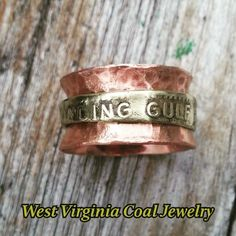 Winding Gulf Coal Scrip & Copper Spinner Ring from West Virginia Coal Jewelry  -http://www.wvcoaljewelry.com/Products.html