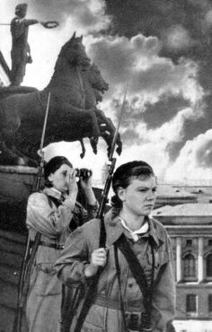 World War II, in Russia – the Great Patriotic War (22 June 1941 – 9 May 1945). Girls – air defence observers on the roof of the Mariinsky Theatre in besieged Leningrad, Russia. Circa 1941 – 1944.