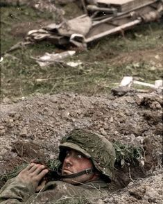 """A Waffen-SS soldier from the 1st SS Panzer Division """"Liebstandarte SS Adolf Hitler"""", in his foxhole in the frontline during the Kursk Offensive, July, 1943. The 1st SS Panzer Division was the best equipped and one of the best divisions in the Waffen SS. They were tasked with protecting the Füher's person, his offices, and residences, as well as fighting as one of the spearheading units within the German army during WW2. They fought in almost every major theater in Europe - pin by Paolo…"""