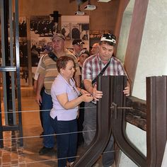 Blind visitors experience the Yad Vashem's Holocaust History museum by touching some of the artifacts on display