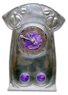 Archibald Knox (1864-1933) - For Liberty & Co. - Tudric Table Clock. Polished Pewter and Enamel. Circa 1902.
