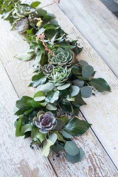 eucalyptus and succulent garland.  Would be nice with candles intersperced..