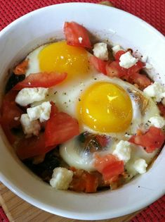 You haven't had eggs until you've had eggs Greek style! This Greek baked eggs recipe is full of healthy veggies plus salmon as added protein.