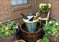 10 Inventive Designs for a DIY Garden Fountain DIY Wine Bottle Fountain