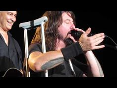 Dave Grohl of the Foo Fighters Invites a Drunk Crying Man On Stage to Sing 'My Hero' With Him
