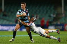Bernard Foley of the Waratahs is tackled during the round 13 Super Rugby match between the Waratahs and the Stormers at Allianz Stadium on May 11, 2013 in Sydney, Australia.