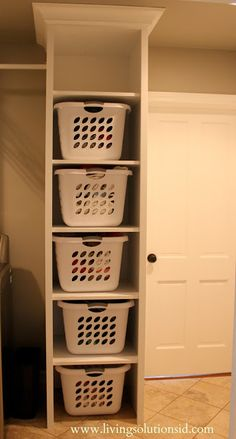Use laundry room shelves to hold laundry baskets.