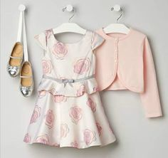 Your blooming beauty will adore our rose print dress in sleek satin. The swingy…