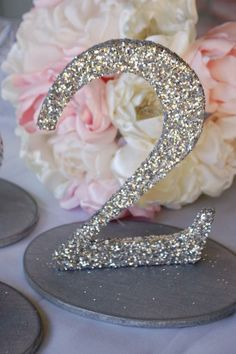 Take wooden numbers and dip them in glitter!