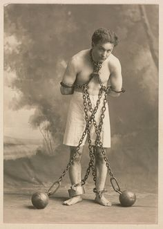 Studio photograph of Houdini in white trunks and chains, c. 1905, modern photograph. Harvard Theatre Collection, Houghton Library, Cambridge, Massachusetts.