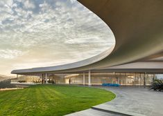 Southcape golf clubhouse by Mass Studies has curving concrete canopies