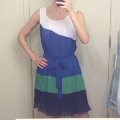 ❗️ bebe Sleeveless Pleated Color Block Dress ❗️Super Sale❗️ Worn twice but still in excellent condition.  It's a loose pleated dress that ties around the waist.  You can make this work for spring, summer and fall for sure.  I set up one of my early fall looks for some ideas.  Bundles save more!!  No trades.  No holds.  bebe Dresses Mini