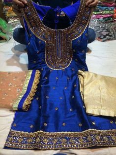 Royal blue and gold salwar kameez by Madaan Cloth House Phagwara.