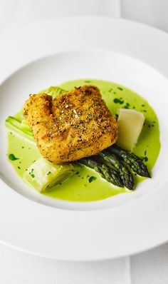 Breaded hake, asparagus and wild garlic sauce. This recipe by Peter Biggs is a celebration of spring, combining succulent herb-crusted hake with tender asparagus and a vibrant wild garlic sauce. Baked Hake Recipes, Fish Recipes, Seafood Recipes, Cooking Recipes, Breaded Fish Recipe, Baked Fish, A Food, Food And Drink, Fish Food