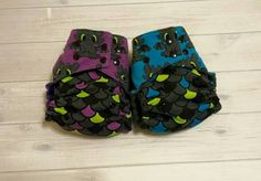 This is a One Size pocket diaper featuring a dimple minky inner, layer of hidden PUL, and a knit outer. This listing is for the PURPLE Toothless diaper. Inserts are not included but can be purchased separately. Our OS diapers fit approximately 8-30lbs