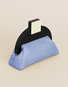 Deco clutch from Matter Matters featuring a retro and elegant effect. Striking geometric forms, bright and bold colour blocks, soft supple leathe...