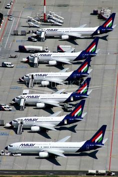 A lineup of various Malév Hungarian Airlines Boeing Airplane Travel, Military Helicopter, Commercial Aircraft, Above The Clouds, Civil Aviation, Flight Deck, Cabin Design, Budapest Hungary, Europe