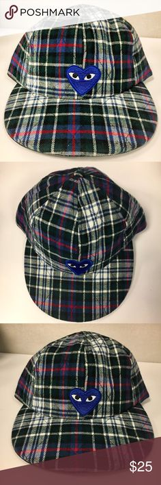 American Apparel CDG Flannel Adjustable Snapback This is a flannel, six panel American Apparel hat with a Comme des Garçons blue patch. I loveeee this hat, it's just a bit big on me so I've only worn it twice (I have a really small head!). It's an adjustable SnapBack and perfect for winter or fall! American Apparel Accessories Hats