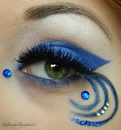Artistic royal blue swirled eye makeup with blue and clear crystal accents by MUA Krissii.