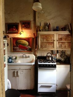 A kitchen in NOLA taken by Liang, the manicurist at Nordstrom.  The cabinets are painted with jars, pantry items etc. Amazing.