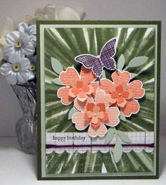by Marsha Reed (Iowa, USA), Video of the bouncing brayer technique - https://www.youtube.com/watch?v=GgJxKw9-IVI Stamp Sets: Flower Shop, Kinda Eclectic, Teeny Tiny Wishes; Inks: Blackberry Bliss, Calypso Coral, Crisp Cantaloupe, Mossy Meadow, Tuxedo Black Memento; Card Stock: Calypso Coral, Crisp Cantaloupe, Moonlight Designer Series Paper Stack, Mossy Meadow, Pistachio Pudding, Whisper White; Accessories & Tools: Pansy Punch, Elegant Butterfly Punch, Petite Petals Punch, Itty Bitty Accents…