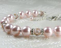 Hey, I found this really awesome Etsy listing at https://www.etsy.com/listing/177798499/pink-pearl-bracelet-swarovski-crystal