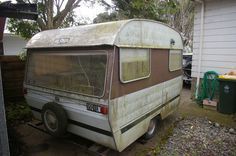 She was found sitting for 25 years neglected and very tired. She had roses growing through her draw bar, a tree had grown around her, and she had sunk into the ground but she will Survive ! It was a very long day ahead of us one Saturday morning [. One Saturday Morning, Retro Caravan, Very Tired, Caravans, Recreational Vehicles, New Zealand, Survival, Roses, Draw