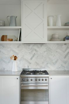 6 Ideas For Introducing Herringbone Patterns Into Your Interior | A twist on the traditional subway tile arrangement, the herringbone pattern as a wall in a bathroom or a backsplash in a kitchen makes for a more unique element and adds the modern herringbone pattern to your home in a subtle sort of way.