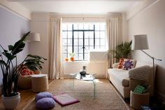 """""""A light rug can open up your room and make it feel larger,"""" says Langdon. A bound carpet remnant can work great. If your apartment came with stained or dark wall-to-wall carpeting, cover it up with a rug in a lighter hue."""