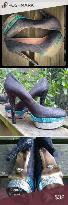 "BETSEY JOHNSON SEANN PLATFORM PUMPS BETSEY JOHNSON SEANN PLATFORM PUMPS Size: 7.5  Super sparkly pumps. Perfect for a club night or during the day with skinny jeans! Betsey Johnson Seann doubled layered  platform shoes. Heel is approx. 5.25"". Platform is approx. 1.5"". The top is glittery  black and the turquoise, silver platform and black heels are sequins. No sequins missing. Only flaw is a very minimun scratch on one side (see picture 4) and signs of wear in the bottom. Other than that…"
