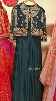 Bottle green Anarkali gown with gold net cape. Click on picture to see lehenga price. #Frugal2Fab