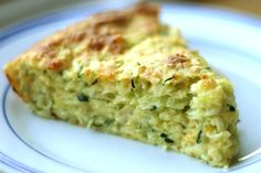Zucchini Pie; my version is slightly different (2 cups Zucchini, 1/2 chopped onion, 2 eggs, 1 cup Bisquick Light, 1 cup cheese, 1/4 cup vegetable oil, and salt/pepper to taste). Have been making for 20+ years, and it's wonderful in the summer served with fresh sliced tomatoes. YUM!