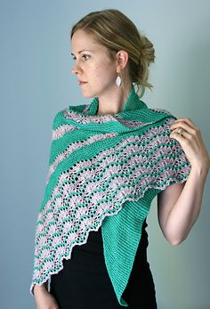 Pennae (Latin for feathers) is a light and feathery asymmetrical triangular shawl that utilizes the beauty of Anzula's new silk and wool blend yarn. Pennae starts out with just one stitch and grows from there, with a simple solid section transitioning into lace stripes, after which a lovely plume of lace finishes the shawl. The lace is an uncomplicated pattern based on Barbara Walker's Porcupine Stitch – a chart and written directions have both been provided for easy execution. Have fun…