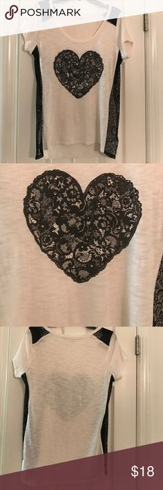 EXPRESS TOP ACCENTED WITH BLACK LACE Cream colored top                                                   Accented with a black lace heart in the middle of shirt  sides of shirt and shoulders are also accented with lace but these parts are see through too cute Express Tops Tees - Short Sleeve