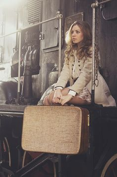 girl to leave with a vintage suitcase