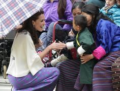 Pin for Later: The Duke and Duchess of Cambridge's Most Precious Moments With Kids  Kate met a young child during an archery demonstration on the couple's trip to Bhutan in April 2016.