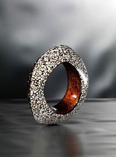 Salome Lippuner  Bracelet: Urushi Rankaku black & White 2010  Egg shell, gold foil, wood