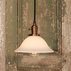 Kitchen Lighting with Vintage Milk Glass with Soft Tapered Design and Exposed Socket. $128.00, via Etsy.
